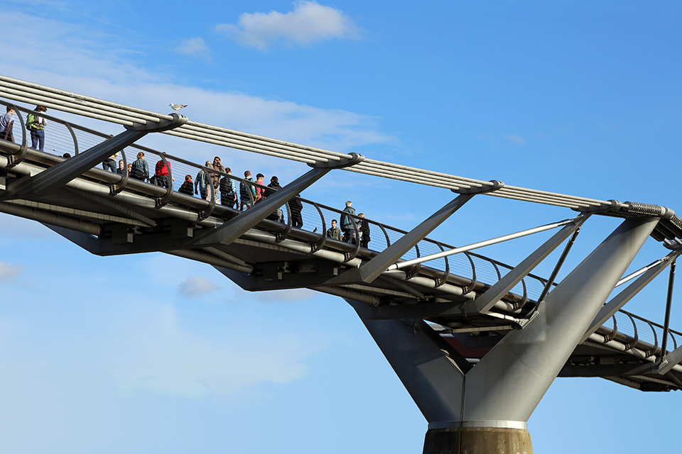 photo of people walking on bridge image not showing from whence they came or go