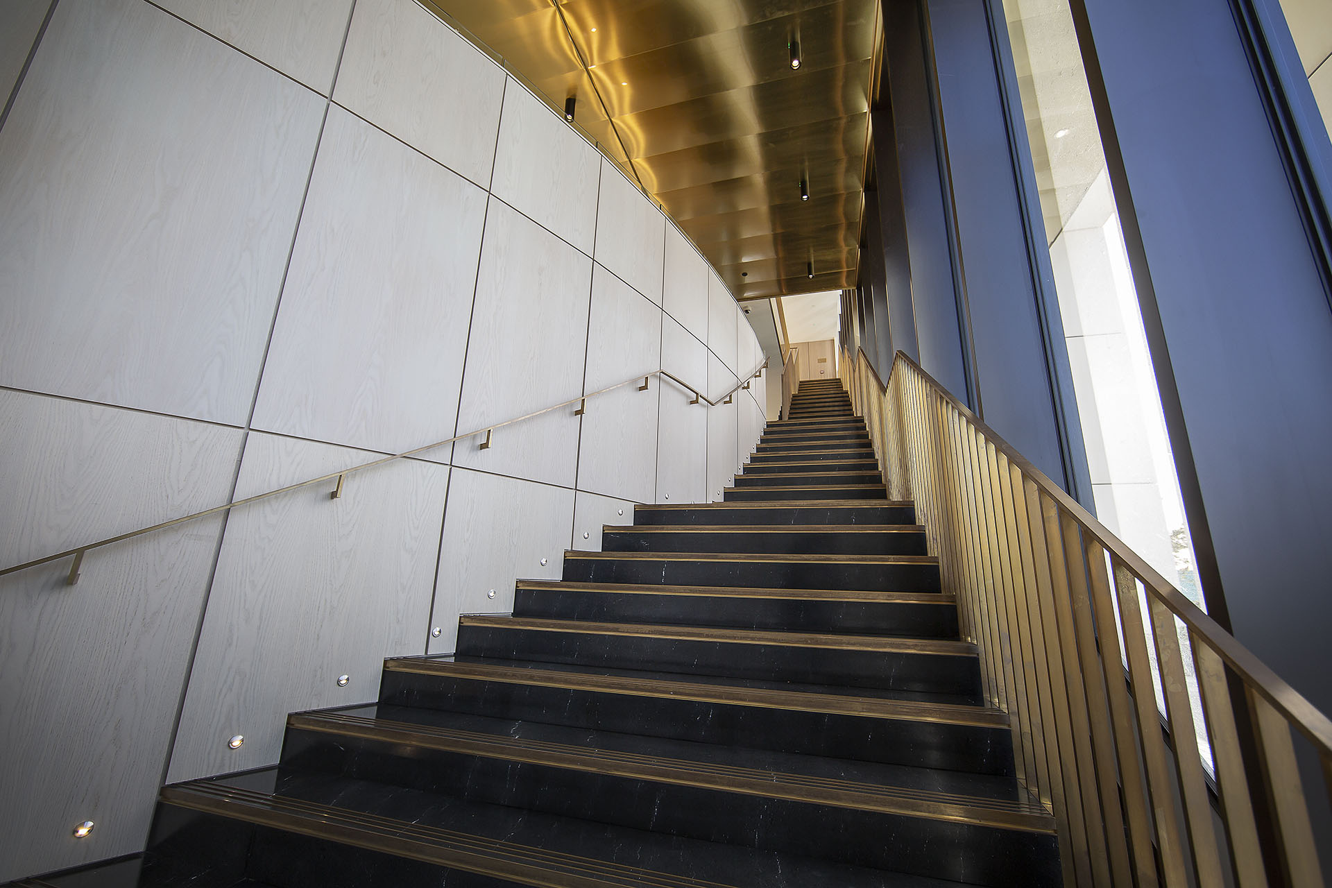Stairs leading to study area on mezzanine floor adjacent to library with cinema above