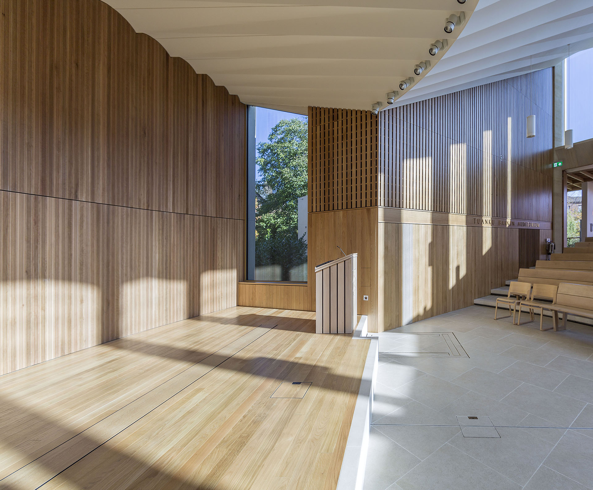 Window to gardens, Lecter, and stage area all within auditorium